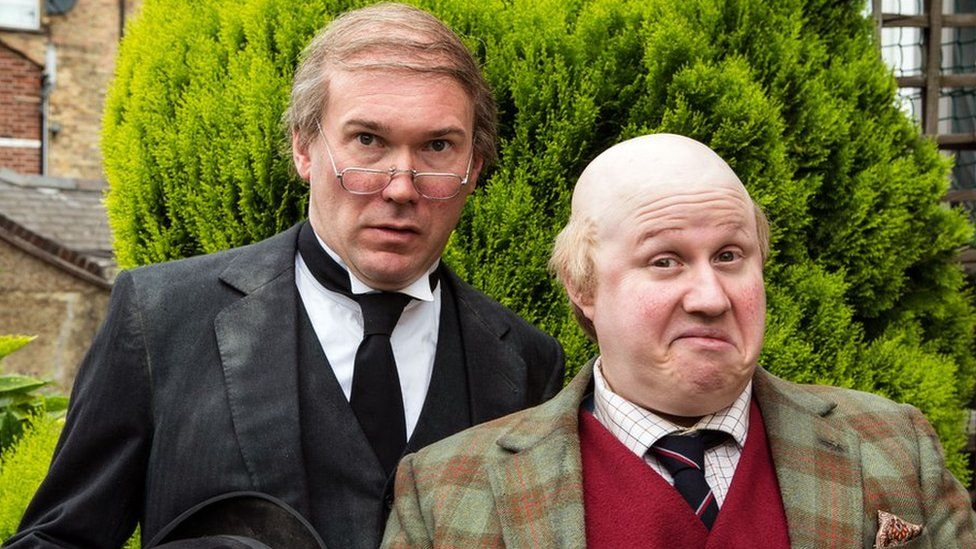 A scene from Pompidou with Alex MacQueen as Hove, butler to Pompidou played by Matt Lucas