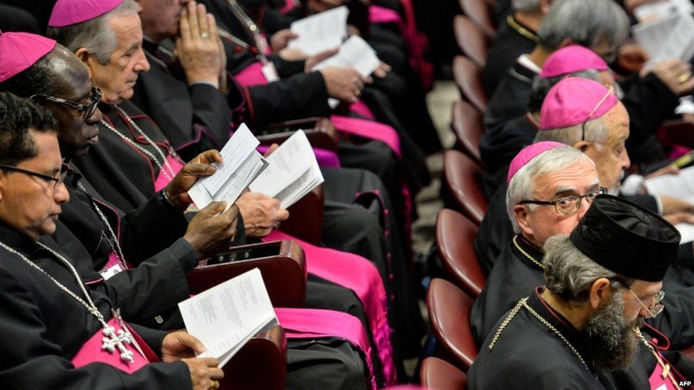 Bishops reads books at a meeting of the synod