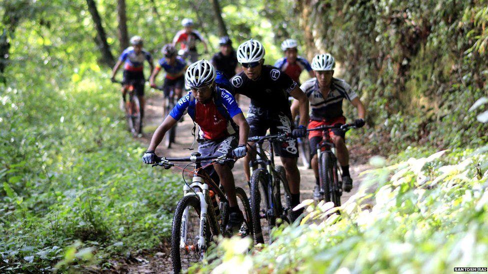 Nepali cyclists on a mountain track