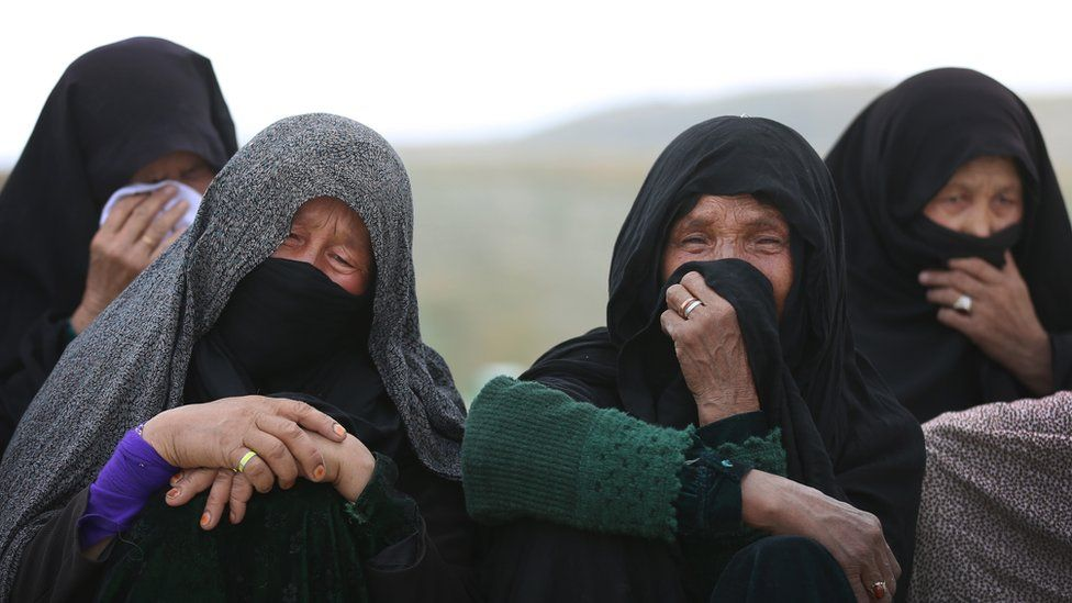 Relatives mourn at the funeral of a pregnant woman killed in the attack