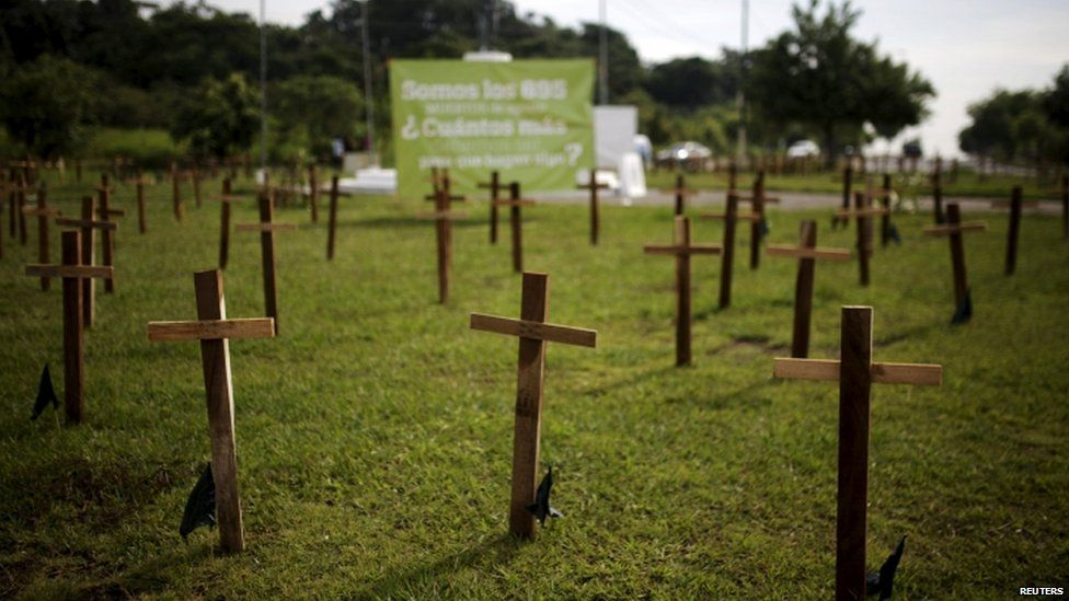 """Crosses are left as a protest against the high homicide rate in the country in San Salvador, El Salvador on September 1, 2015. Members of a civilian group called """"300"""" called the protest against homicides in El Salvador."""