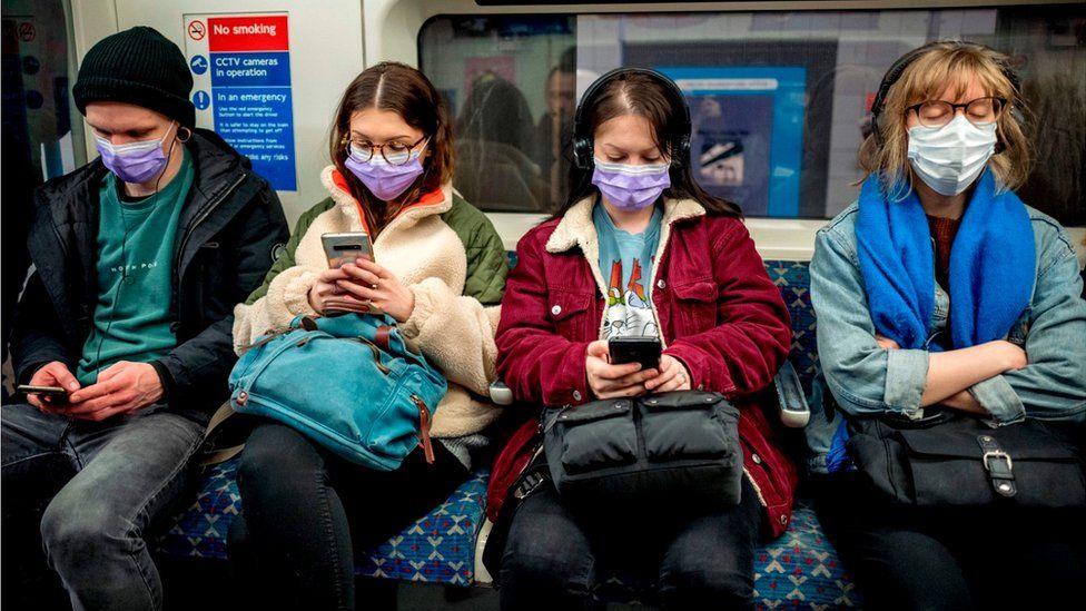 People on Victoria Line train