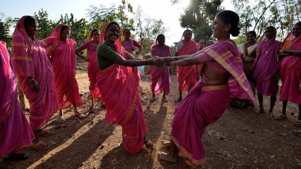 women dancing outside
