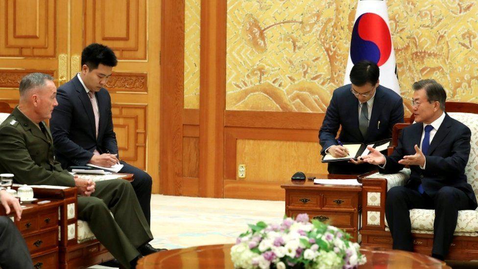 Gen Joseph Dunford (L) and President Moon Jae-in (R)