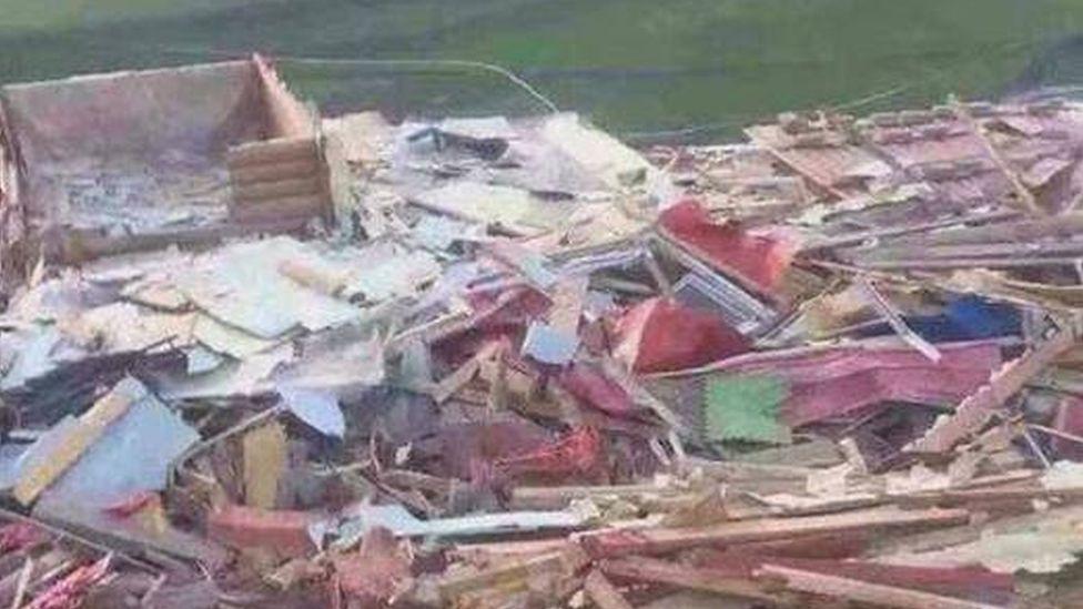 Destroyed log cabins