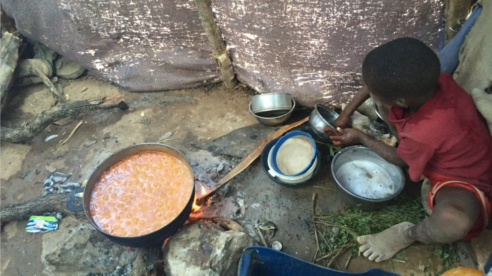 One of Mr Giles children helps prepare food at Parc Cadeau