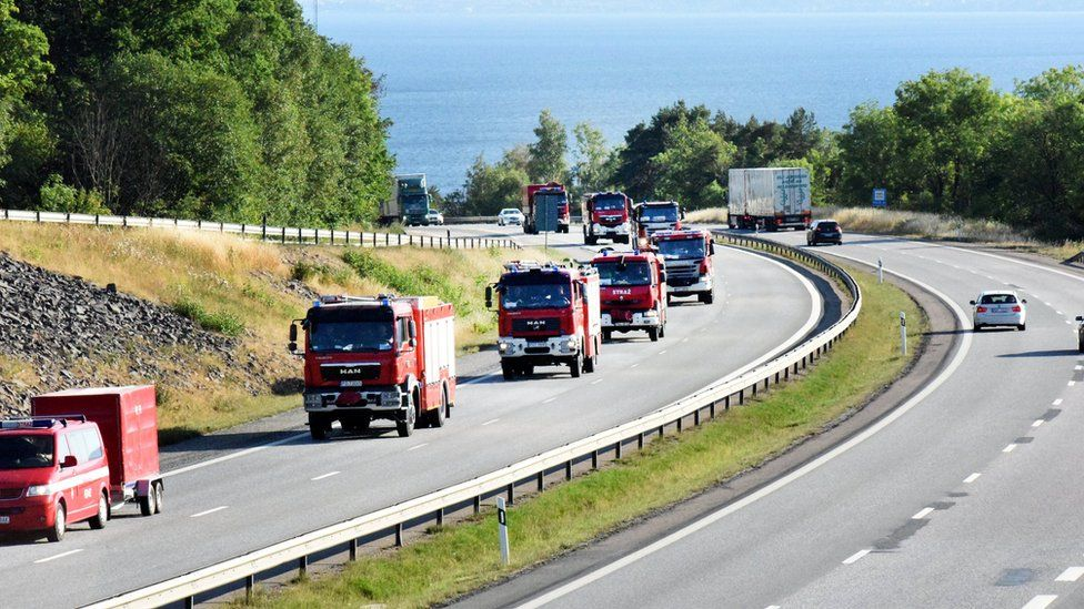 A convoy of Polish Fire Brigade passes lake Vattern on their way to Uppsala, after a rest and refuelling in Uppsala the Polish firefighters will continue during Sunday to central Sweden where they will help to put out the major wild fires