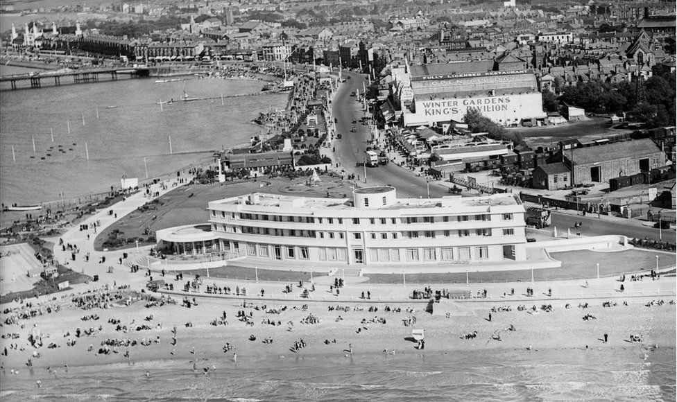 An aerial view of The Midland Hotel and the sea-front in Morecambe, taken in August 1934