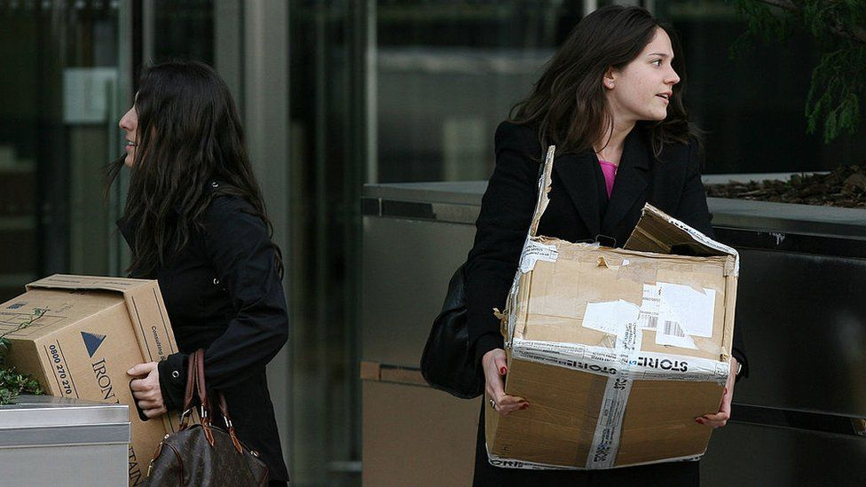 Two women leave Lehmans with boxes