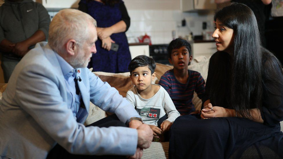 Jeremy Corbyn speaks to a mother at Clyde House in Putney