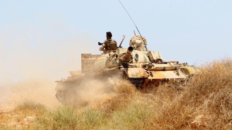 a Libyan tank on a grassy hillside, June 10 2016