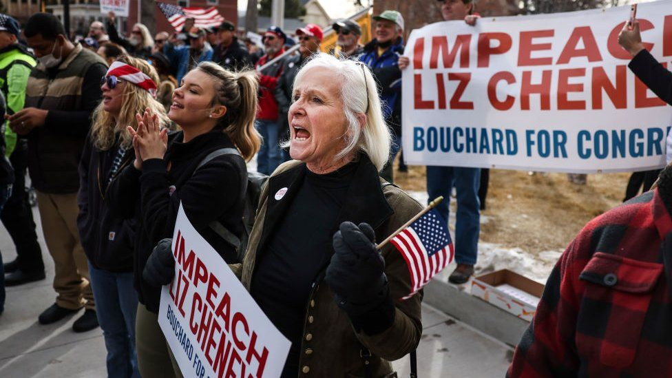 People cheer as Rep. Matt Gaetz speaks to a crowd during a rally against Liz Cheney on 28 January in Wyoming