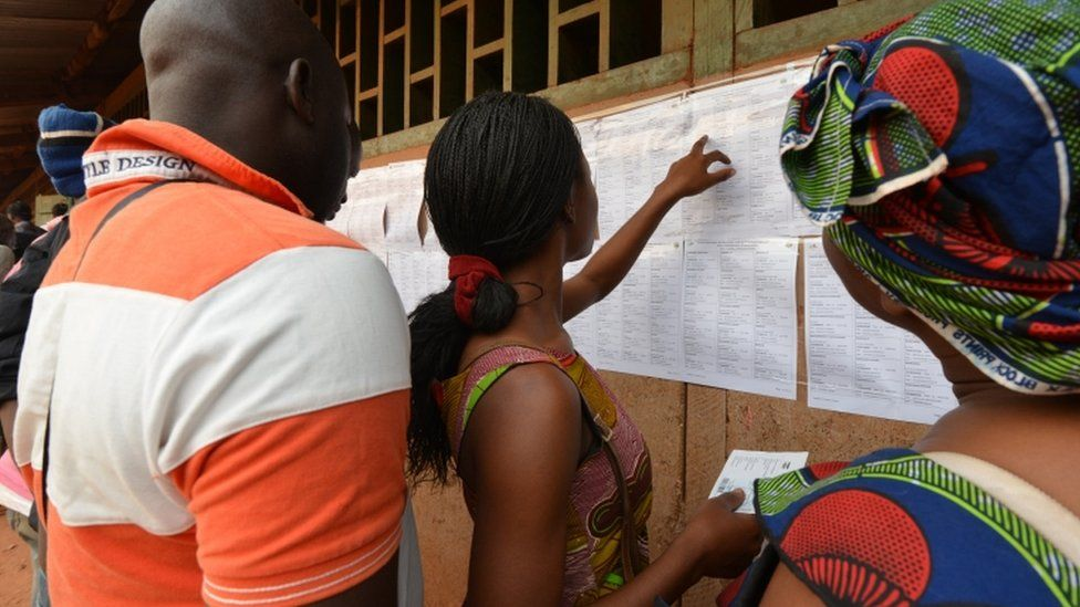Voters check for their names on a list at a polling station in Bangui on December 30, 2015 as people go to the polls to take part in the country's presidential and legislative elections