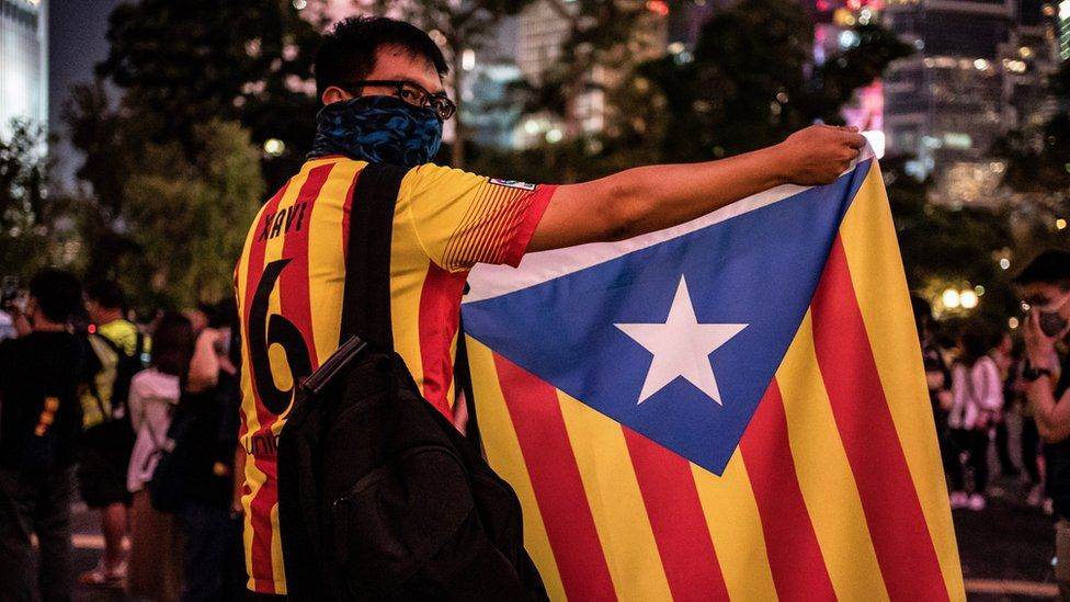 A protester in Hong Kong holds up a a Catalan pro-independence Estelada flag