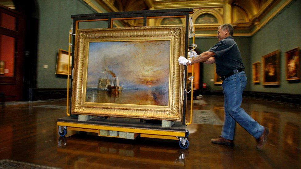 A National Gallery employee moving JMW Turner's 1839 work The Fighting Temeraire