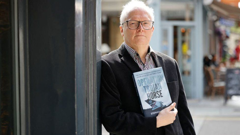 Journalist and author Stephen Davis poses with his new book Operation Trojan Horse