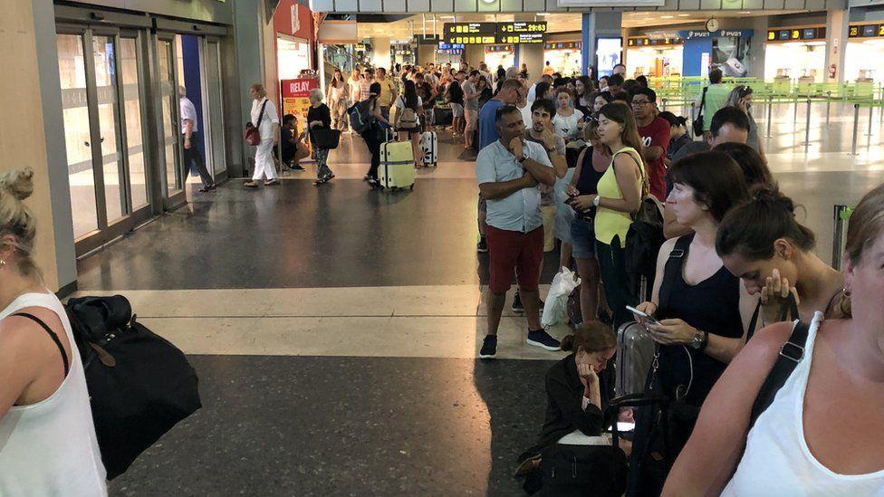 Passengers queuing inside Valencia Airport