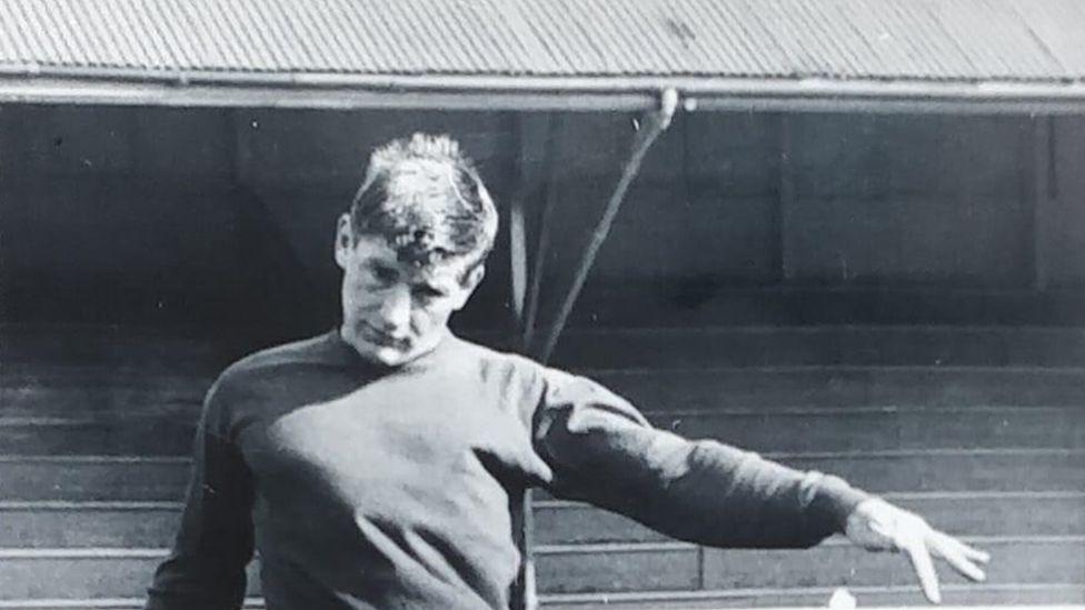 Brian playing football