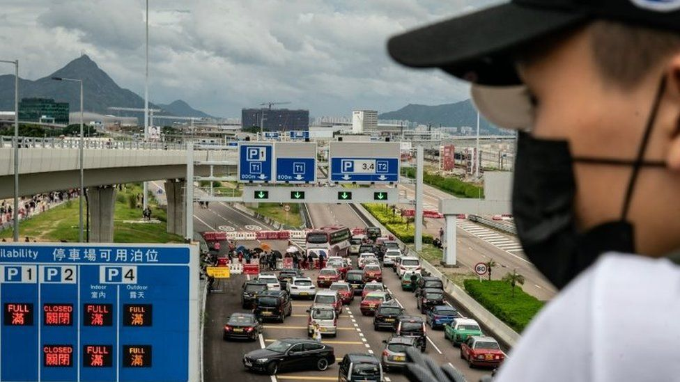 A protester looks at a blocked road to Hong Kong's airport. Photo: 1 September 2109