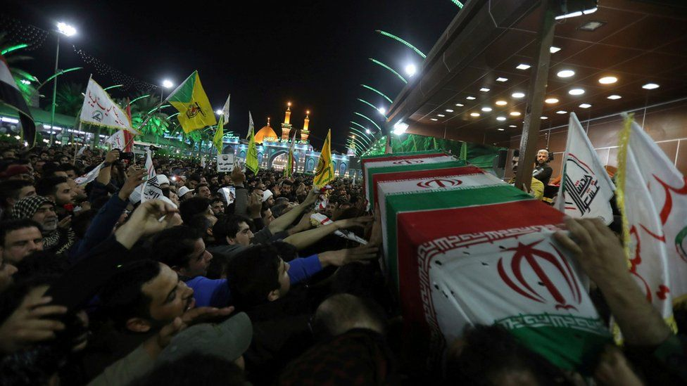 Mourners attend the funeral procession of Qassem Soleimani and Abu Mahdi al-Muhandis in Karbala, 4 January
