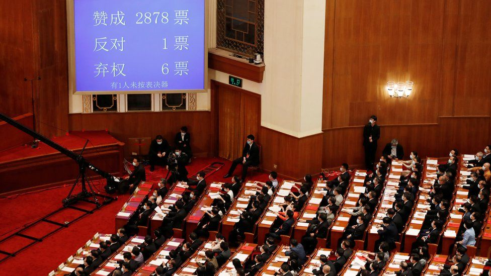 """A screen shows the results of the vote on the national security legislation for Hong Kong Special Administrative Region at the closing session of the National People""""s Congress"""