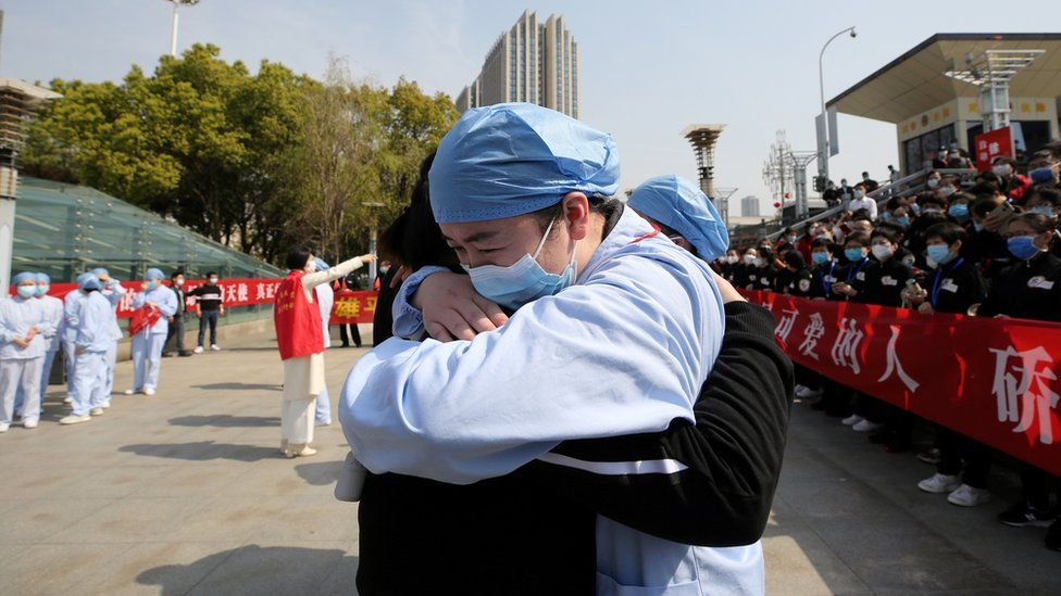 Two medical workers embrace in Wuhan, China