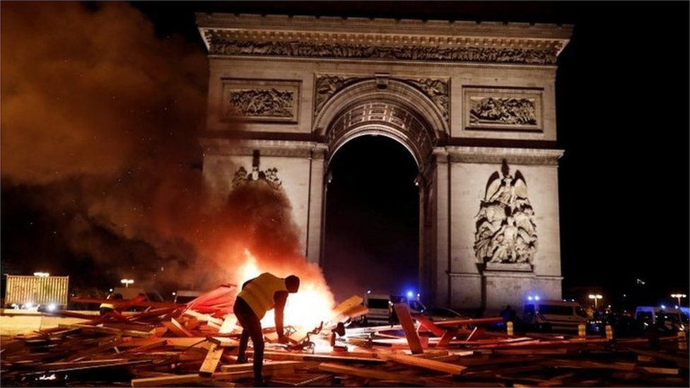 A a burning barricade during a yellow vest on the Champs-Élysées, 24 November