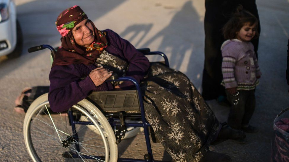 A Syrian refugee in a wheelchair at the Turkish border