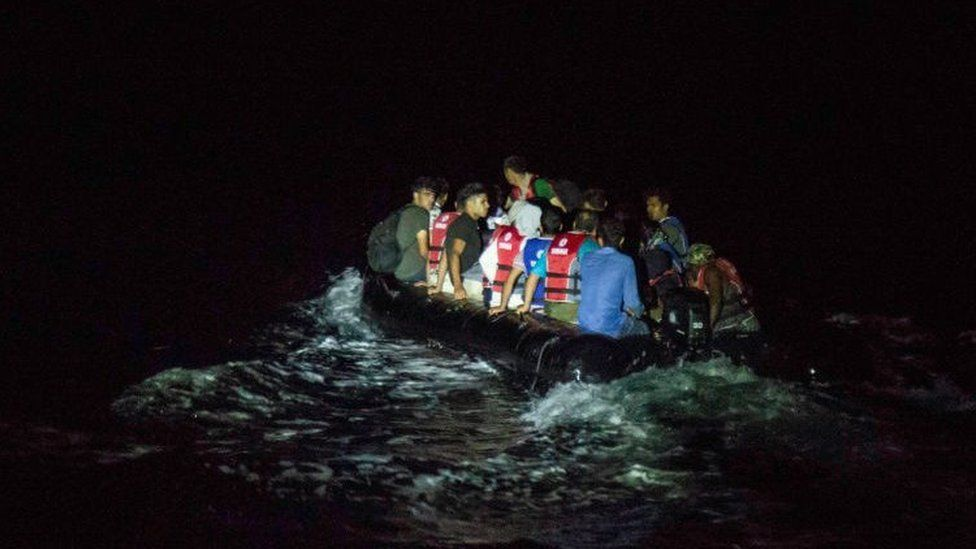 A rubber dinghy full of migrants crossing to the Greek island of Lesbos at night