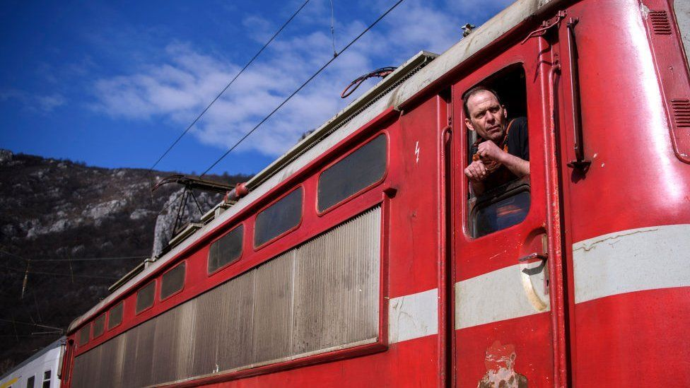 A picture of an old read train carriage in Bulgaria