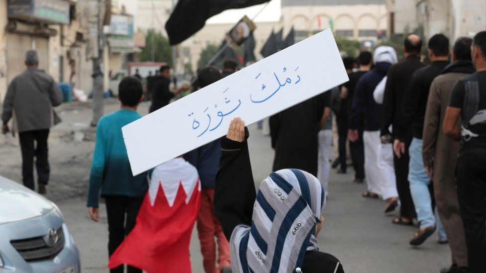"A Saudi Shia woman holds a placard saying ""Your blood is a revolution"", during a protest in the eastern coastal city of Qatif against the execution of the cleric Nimr al-Nimr (8 January 2016)"