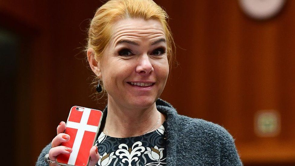 Then-Interior Minister Inger Stojberg holds her phone showing a Danish flags in November 18, 2016