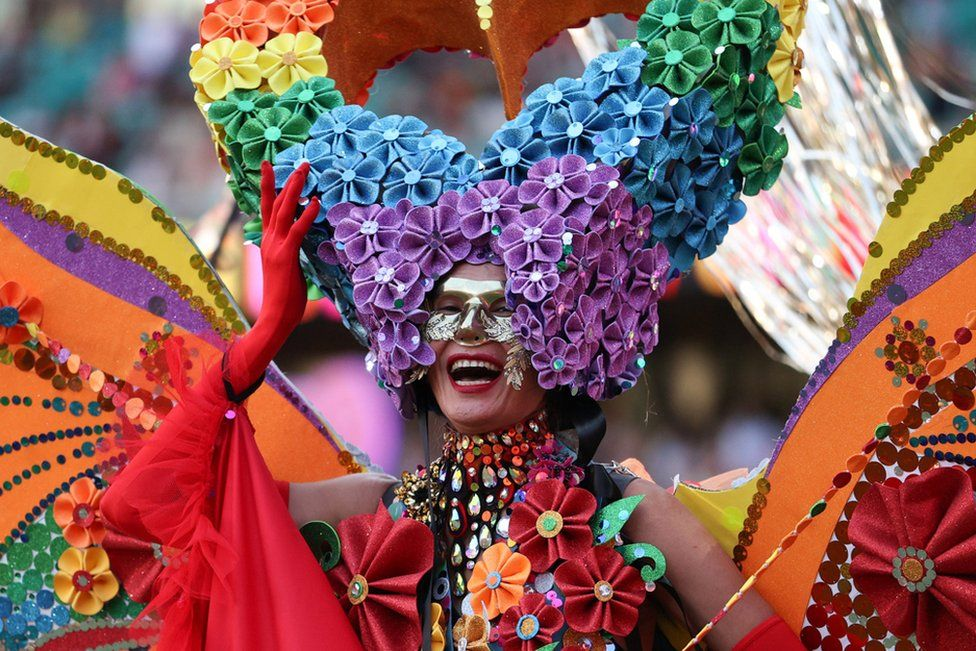 A participant celebrates the Sydney Gay and Lesbian Mardi Gras Parade under coronavirus disease (COVID-19) safety guidelines at the Sydney Cricket Ground in Sydney, Australia, 6 March 2021.