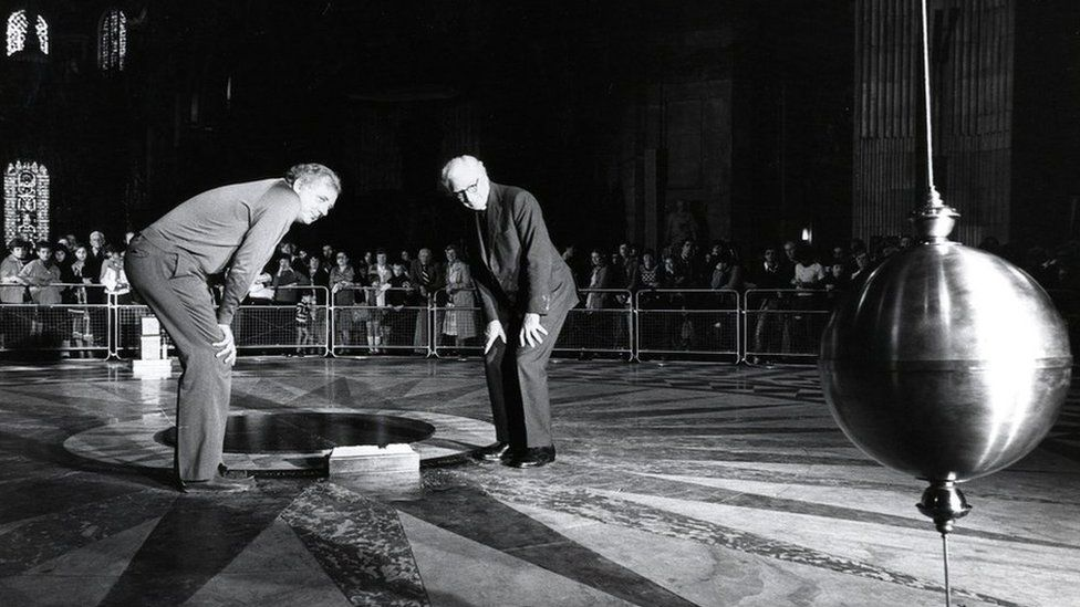 The Open University and BBC reconstruct the famous Foucault experiment, which proved the earth goes around the sun, by hanging a brass ball 300ft from the roof of St Paul's Cathedral in London.