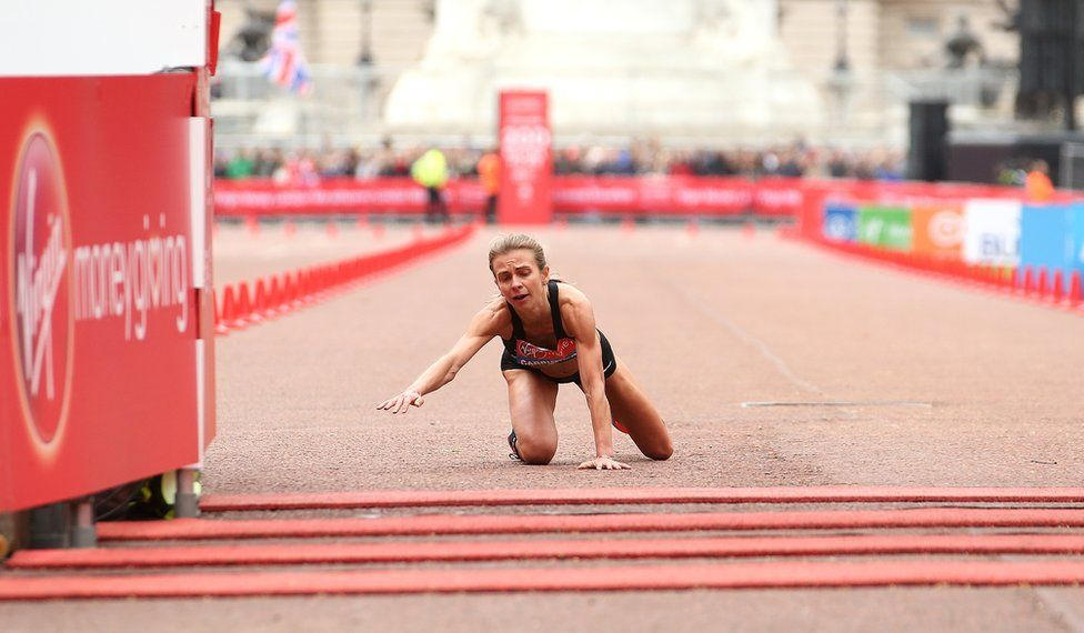 Hayley Carruthers crawls over the finish line