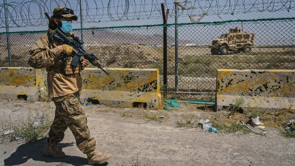 Taliban fighters guarding the perimeter of Kabul airport on 29 August