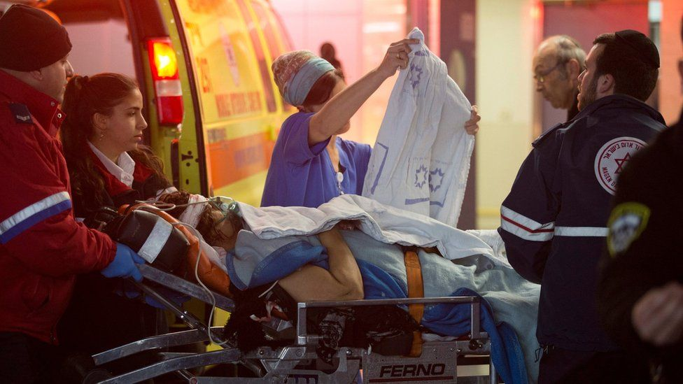 Emergency teams handle a wounded Israeli following a stabbing attack, at the Shaare Zedek Medical Center in Jerusalem, Israel, 25 January 2016.