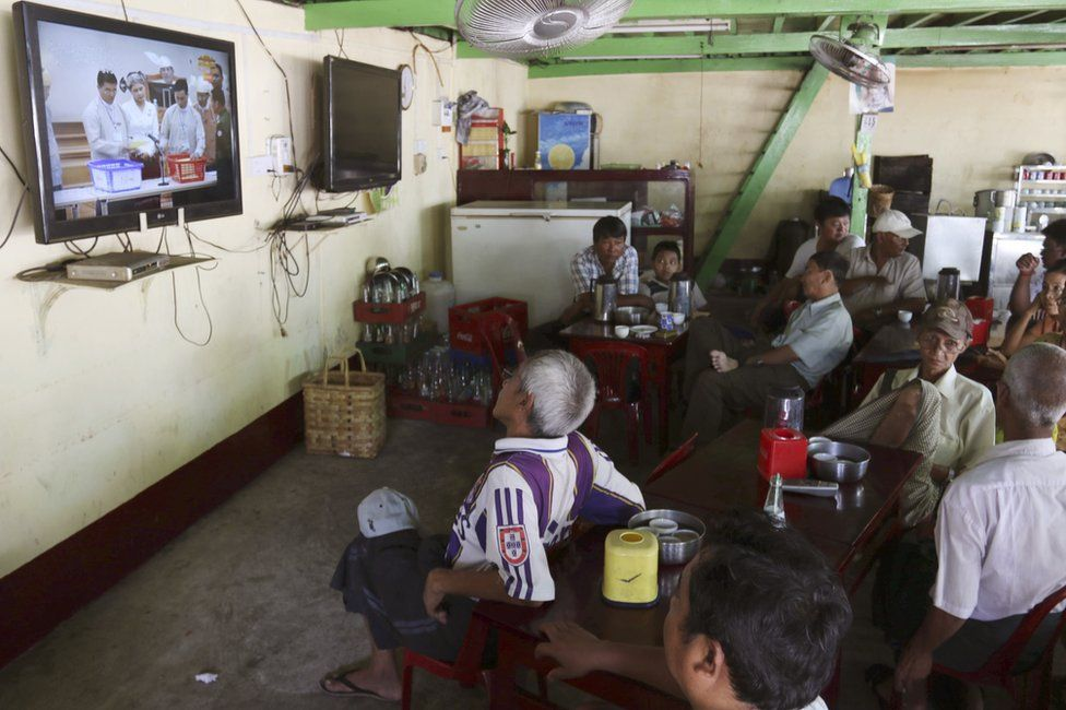 "People watch the live broadcast of Myanmar""s presidential election at Parliament Tuesday, 15 March 2016, at a teashop in Yangon, Myanmar"