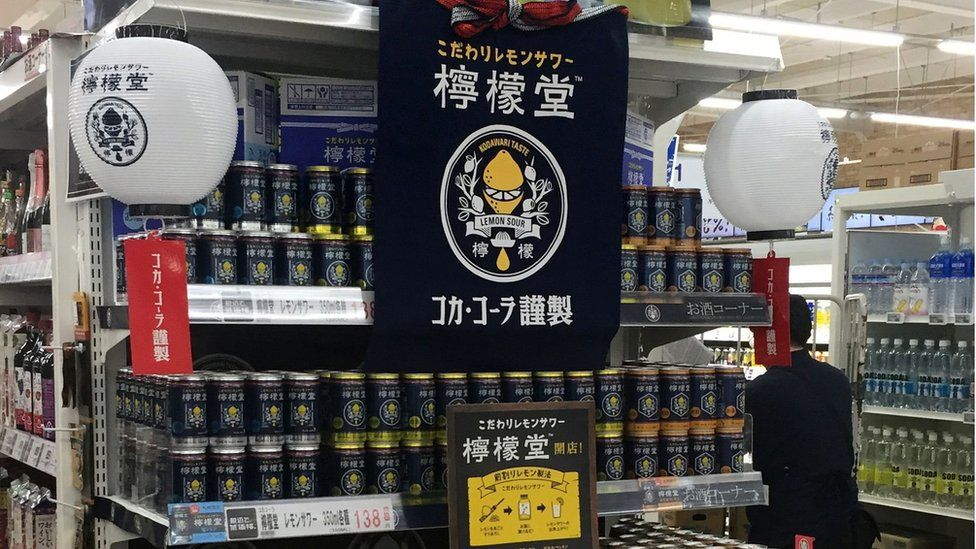 The new cans on a supermarket shelf