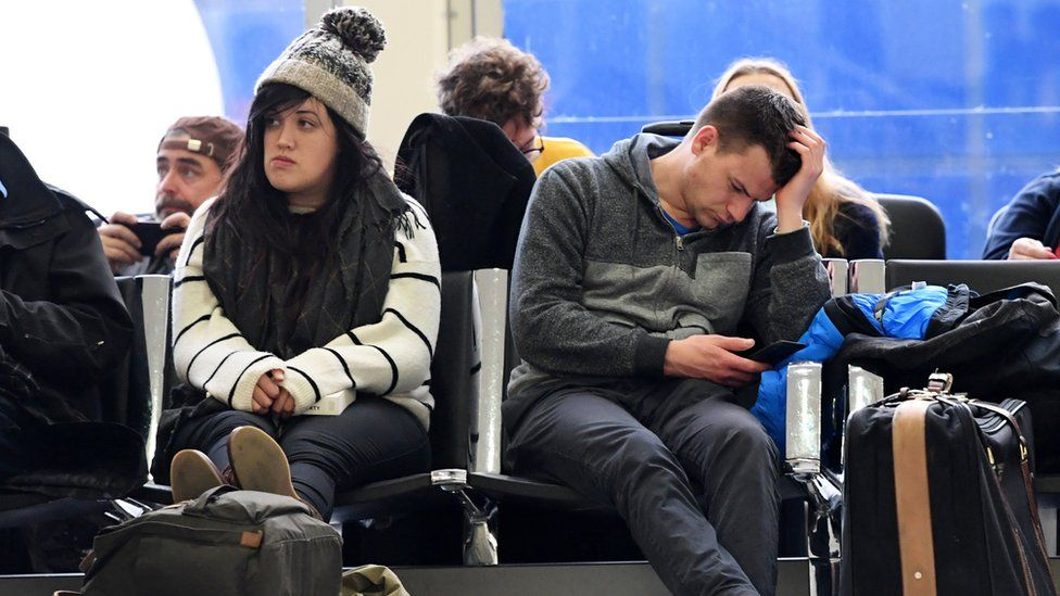 Passengers waiting for a flight at Gatwick airport in Sussex