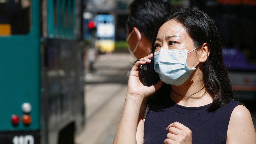 A woman wears a surgical mask in Hong Kong