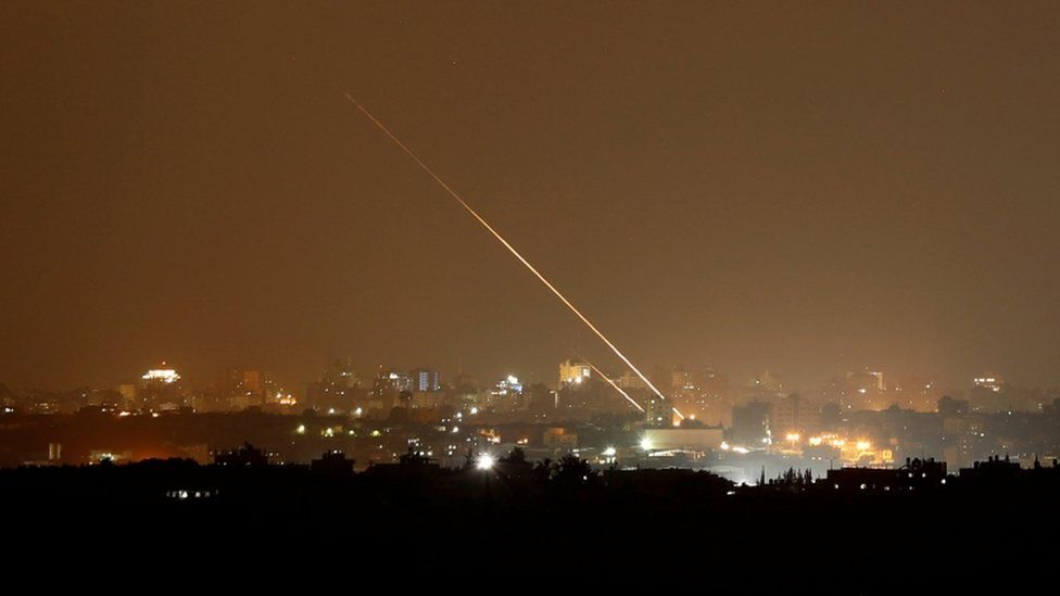 Rockets are launched from the northern Gaza Strip towards Israel, as seen from Sderot, Israel
