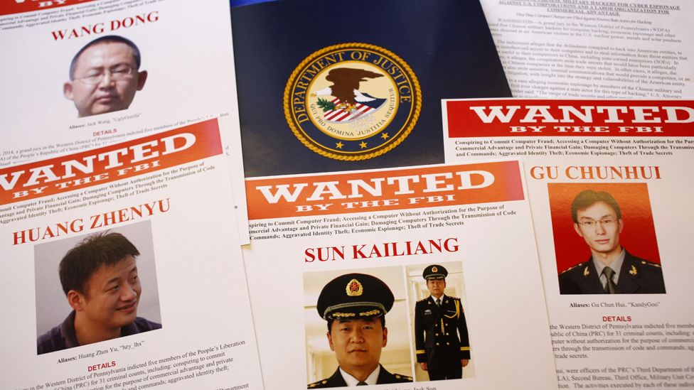 FBI (Federal Bureau of Investigation) press materials are displayed on a table of the Justice Department in Washington, Monday, May 19, 2014. A U.S. grand jury has charged five Chinese hackers with economic espionage and trade secret theft, the first-of-its-kind criminal charges against Chinese military officials in an international cyber-espionage case.