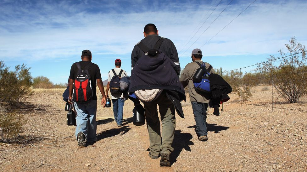 Mexican immigrants walk through the Sonoran Desert after illegally crossing the U.S.-Mexico border border on January 19, 2011 into the Tohono O'odham Nation, Arizona.