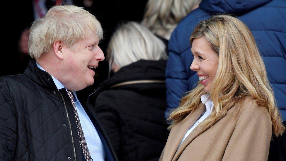 Boris Johnson and Carrie Symonds in March 2020 at Twickenham Stadium