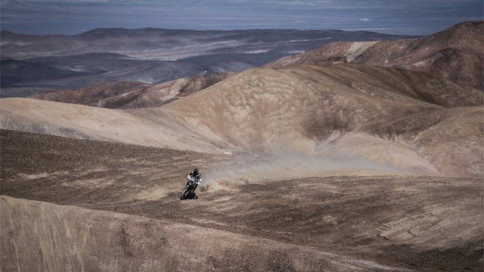 A handout photo made available by RallyZone shows Chilean Pablo Quintanilla participating in the third stage of the Atacama Rally, between Taltal and Mejillones, Chile, 16 August 2017.