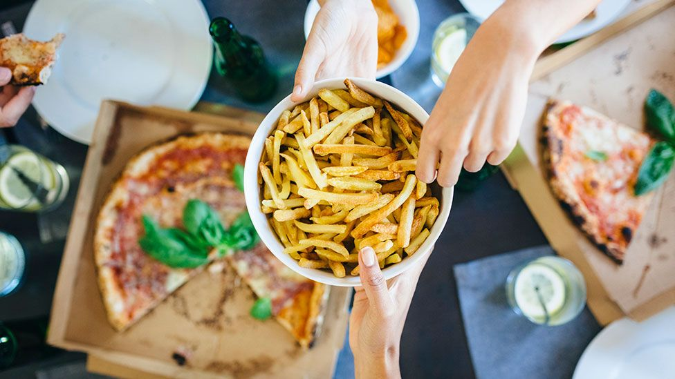 Stock image of pizza and chips