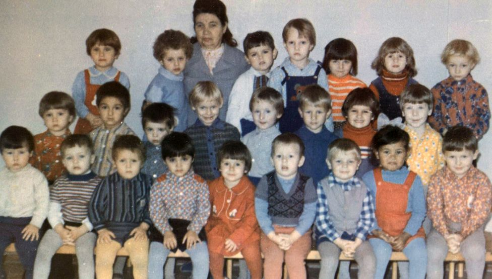 Farhiya as a child with her classmates (front row, second from right)