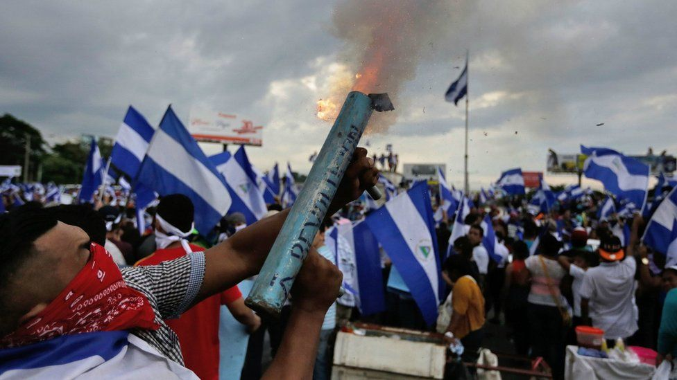 Anti-government demonstrator fires a home-made mortar during a protest in Managua on May 26, 2018