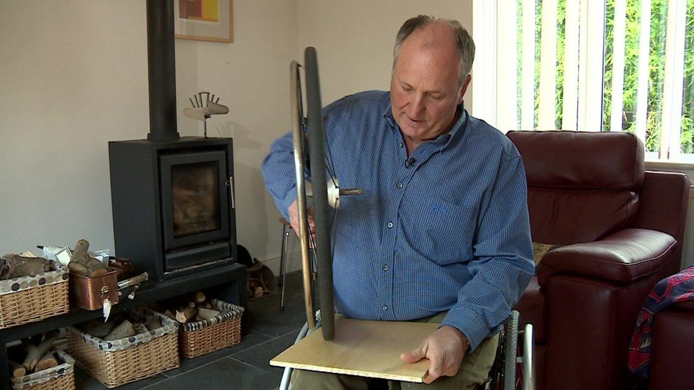 Fred Walden demonstrates how his wheels are specially made not to mark floors
